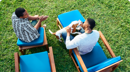 Two people sitting on blue lounge chairs